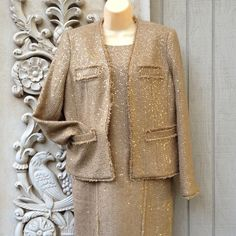 Michael Kors Brown Tweed Jacket & Matching Dress! Fancy meets drab! Gold sequins on rustic brown tweed. Striking raw edged collarless jacket with invisible 2 hook closure. Dress is lined and sleeveless with a zipper back. Super comfy! This outfit looks great with brown boots and looks much better on than appears on the hanger. Fits narrow in the hips. Size 12 Petite. Michael Kors Dresses