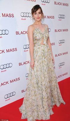 Demure: The Fifty Shades of Grey star wore her light brunette hair in an updo, and added s...