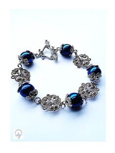 Metallic Blue Bead And Thin Gold Plated Flower Pendant Bracelet With Vintage Clasp - £20.00