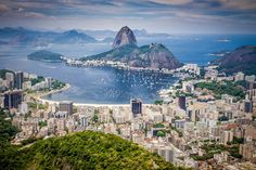 "Known as the ""Marvelous City,"" Rio de Janeiro is one of the most beautiful and spectacular places in the entire world. We compiled the best of the city into this itinerary for a perfect weekend in Rio de Janeiro. Most Beautiful Greek Island, Most Beautiful Cities, Amazing Places, George Town, Brazil Travel, Best Places To Travel, Summer Travel, Samba, Vacation Destinations"