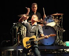 """Bruce Springsteen and the E Street Band perform """"Prove It All Night"""" at Citizen's Bank Park. Drummer Max Weinberg is in the background. (Charles Fox / Staff Photographer)"""