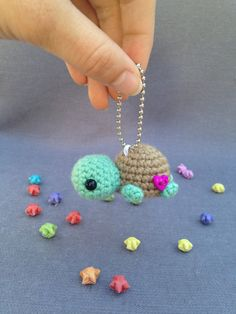 Meet Tilda, the turtle, a sweet little hand crocheted keychain. Add her on your keys or bag and let her come along with you on your adventures. She is made with acrylic/polyamide yarn, and is embellished with a heart button. Height: 1in Width: 2.25in (measurement does not include keychain) This listing is for the finished product, not the pattern. Each turtle is made to order so may vary slightly from the picture. They are handcrafted in a smoke free home. Due to small parts please use...