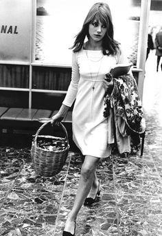 Jane Birkin at the airport with her basket bag. Pictured arriving in London, 1966
