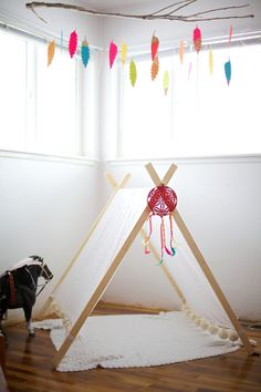 A-Frame Tent and love the feathers from the branch