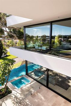 the view of pool and yard from the private balcony on the upper level