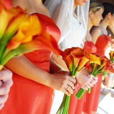 Andrea kept things simple and used only one type of flower for the celebration: burnt orange calla lilies. The bridesmaids each carried seven stems wrapped in gold ribbon, while the bride's version was much larger and wrapped in ivory ribbon.