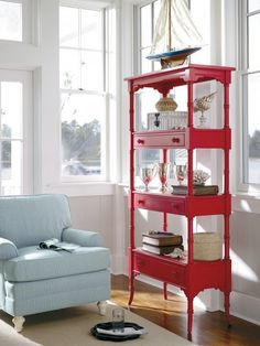 multiple tables split apart, painted and repurposed into shelves and desks. I love the quirky look of these brightly-colored shelving units.