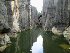 Several ornamental pools are between the eroded limestone formations in the Stone Forest at Shilin near Kunming, Yunnan, China. Kunming, Pools, Tourism, Scenery, Ornaments, Travel, Outdoor, Beaded Jewelry, Blog