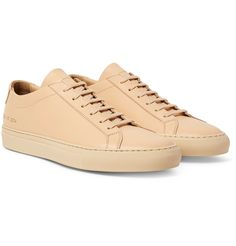 These 'Original Achilles' sneakers from <a href='http://www.mrporter.com/mens/Designers/Common_Projects'>Common Projects</a> are designed to bridge the gap between sporty styles and more formal dress shoes. Designed without superfluous detailing, save the signature gold serial numbers, they've been meticulously crafted in Italy from pristine beige leather. The tonal laces and midsoles create a streamlined look, well-suited for...