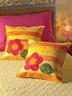 """Brighten a little girl's room with a pair of colorful pillows. The wide pieced stripes combine with a simple applique flower-and-leaf motif for a design that is so easy to stitch and fun to make! This e-pattern was originally published in the February 2012 issue of Quilter's World magazine. Size: 17"""" x 17"""". Skill Level: Beginner"""