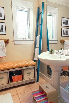 Our Campaign Bench and Bins make for beautiful storage in this cute bathroom in the home of field editor and stylist, Sarah Alba. via Houzz