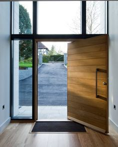 Timber pivot entry door with black framed glazing