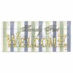 "Add a welcoming touch to your entryway or guest room with this planked wood wall decor, showcasing a striped motif and typographic accent.  Product: Wall decorConstruction Material: WoodFeatures:  Striped motifTypographic accentDimensions: 10"" H x 24"" W"