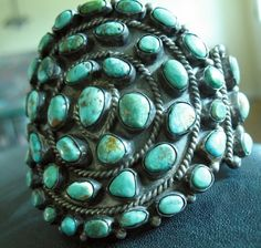 Vintage Navajo Turquoise and Silver. It's a little rougher than we are used to now. The stones are elegant. I think it's perfect.