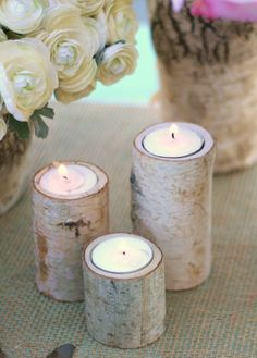 Birch bark vases and votive holders bring a touch of woodland rusticity to an elegant table setting.
