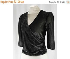 Size 8 Disco Top - Early 1980s Black & Silver Metallic Knit - Sheer Short Sleeved 80s Wrap Style Shirt - Sexy Retro Blouse - Bust 38 - 46893 by vintagevixen on Etsy https://www.etsy.com/listing/468515271/size-8-disco-top-early-1980s-black