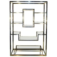 Etagere Brass and Glass Room Divider by Romeo Rega from Italy - Shelve | From a unique collection of antique and modern shelves at https://www.1stdibs.com/furniture/storage-case-pieces/shelves/