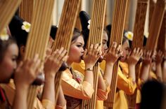 Performers rehearse using a Khean instrument during the 28th Association of Southeast Asian Nations (ASEAN) Summit at the National Convention Centre (NCC) in Vientiane.
