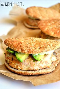 Salmon Burgers topped with avocado and a creamy, refreshing cucumber spread. Cucumber Recipes, Salmon Recipes, Fish Recipes, Seafood Recipes, Dinner Recipes, Cooking Recipes, Healthy Recipes, Grilling Recipes, Delicious Recipes