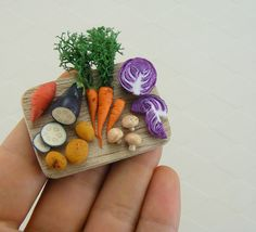 Such amazing detail! Nice find, @pleated seams! Miniature Veggies | Flickr -  The detail on the cabbage!