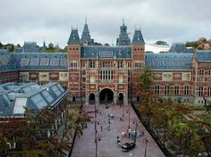 Rijksmuseum  Amsterdam, Netherlands  This museum houses more than 1 million objects. A lot of people go there to see Rembrandts's Night Watch. My favorite was the Milk maid by Johannes Vermeer. I could have stood and stared at it for hours. The pictures you see of these paintings do not do them justice.