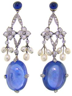Art Deco Sapphire & Diamond Earrings circa 1920. Original Art Deco Sapphire & Diamond Earrings circa 1920, the sapphires weigh 14.29 carats and 13.48 carats respectively in addition to 46 diamonds and pearls enhancing the earrings. The drop measures approximately 1-3/4 inches.  Sold by Fourtane, listing via 1stdibs.