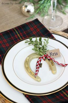 Holiday table with equestrian accents including name tags tied onto gold spray painted horseshoes