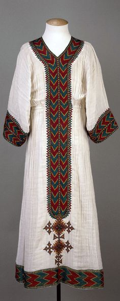 Africa | Woman's dress; very fine handwoven cotton cloth embroidered around the hem, neck and arm openings | Addis Ababa, Ethiopia | ca. 1993 or earlier