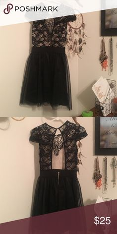 Black holiday  midlength dress. It has a sheer skirt. The top is all lacy. The back is open. It's sassy but classy. The perfect dress for any event. It was only worn once for a family party. It is shorter mid length dress. It's is perfect for a night out or the holidays. WINDSOR Dresses Mini