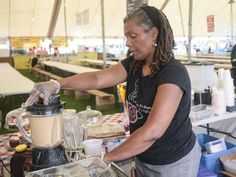 Geneva Hall of Somerset makes a Caramel Mocha Chocolate Frappe coffee, at the Somerset County Action Program's Week of the People booth in the food tent at the Somerset County 4H Fair in North Branch Park on August 10, 2016. (Photo: Keith Muccilli/ Staff)