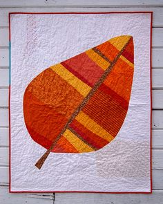 "It's supposed to be a leaf.  My kids think it looks like a pear.  If I make another, there are some things I'll change (like angle the patch...  Finishes approximately 36"" x 45""."
