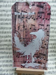 Lost Coast Designs Bird embossed in white on mixed media background :)
