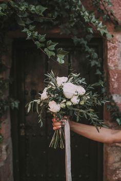 White Bridal Bouquet - Ernesto Villalba Photography | Elegant Outdoor Spanish Wedding with Olive Branches & White Flower Decor | Open The Door Events | Hacienda la Colora Venue