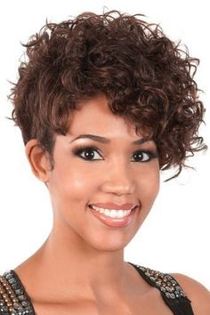 Go Girl Curly Wig, 96. Unbalanced/Asymmetrical on one side, top to bottom 9 inches. Short and tapered, curlable wig. Heat resistant up to 400F