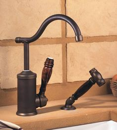 French Country Charm-Herbeau Flamande faucet & handpray in Weathered Copper & Brass.