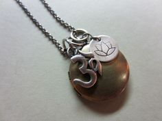 Locket, Om and Lotus Charms Necklace. $68.00, via Etsy.