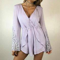 """Lavender Crochet Romper S M A slip on style romper, fabric is very soft in a gorgeous light lavender. Perfect for spring & summer! Waist features an elastic band, very stretchy & comfortable! Features bell sleeves with beautiful crochet detailing. Can be worn with a belt. Fully lined. Size M measures 18"""" across the chest and 28"""" in length. 100% Rayon. Boutique Other"""
