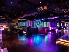 7 Heaven night club in Lan kwai Fong, Hong Kong designed by Liquid Interiors. night club design, nightlife design, LED screens, booth design, colorful lighting, cove lighting, wood flooring, lit stairs, simple and modern