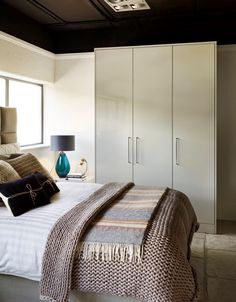 Sleek, high gloss fitted wardrobes from John Lewis of Hungerford in our Urban style, partnered with skinny curved handles in brushed steel finish. http://www.john-lewis.co.uk/bedrooms/contemporary-urban-bedroom