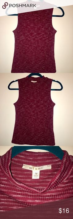 NWOT Maroon Sleeveless Mock/Cowl Neck Top Size M Never Worn!!! Brand New NWOT Maroon Sleeveless Mock Turtleneck or Cowl Neck Top from Francesca's. Size Medium but could easily fit a size Small, size 0, size 2, size 4 or Medium. Stretchy top. Would look super cute alone, tucked into a work skirt, with a sweater, or Tucked into a hair of high waisted pants or jeans. Never worn before! Brand new. Bought as a Christmas gift but ended up never gifting. Would look fab with an edgy fun statement…