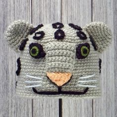 "SNOW LEOPARD ~ Crocheted Animal Hat ♦ Pattern in ""Amigurumi Animal Hats"" by Linda Wright. http://amazon.com/dp/098009237X/"