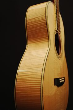 Custom Circa 00 with flame maple back and sides and bearclaw spruce top. Based on a Martin 00 but with a deeper body. Circa Guitars by John Slobod
