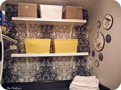 Using interesting fabric and liquid starch to decorate apt walls without damage