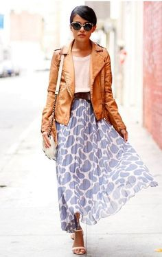 Juxtaposed styling. Tough motor jacket with feminine pleated skirt with organic interesting prints