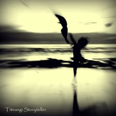 Impressionist dancer on the beach at sunset, Piha, Auckland New Zealand.
