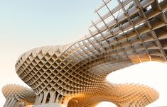 "The wooden Metropol Parasol, also known as ""las setas"" (the mushrooms), winds above the rooftops and houses a cafe, concert space, and market."
