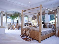 Designer's Notes.  Classic neutral colors and playful details make this bedroom a tropical paradise.