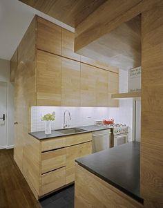 White tile backsplash, dark tiled floors, wood. Clean and simple.