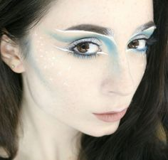 ice queen look, light turquoise blue and white eyes, blue contour