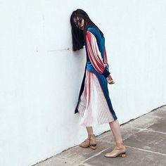 Fashion_pleat panel dress worn with ankles 📷 from yuulyie_official instagram | Saved by Gabby Fincham |  @yuulyie_official Beige boots with lego heels featured in #shanghaifashionweek MODE editorial by @yyo.com.cn. #YUULYIE